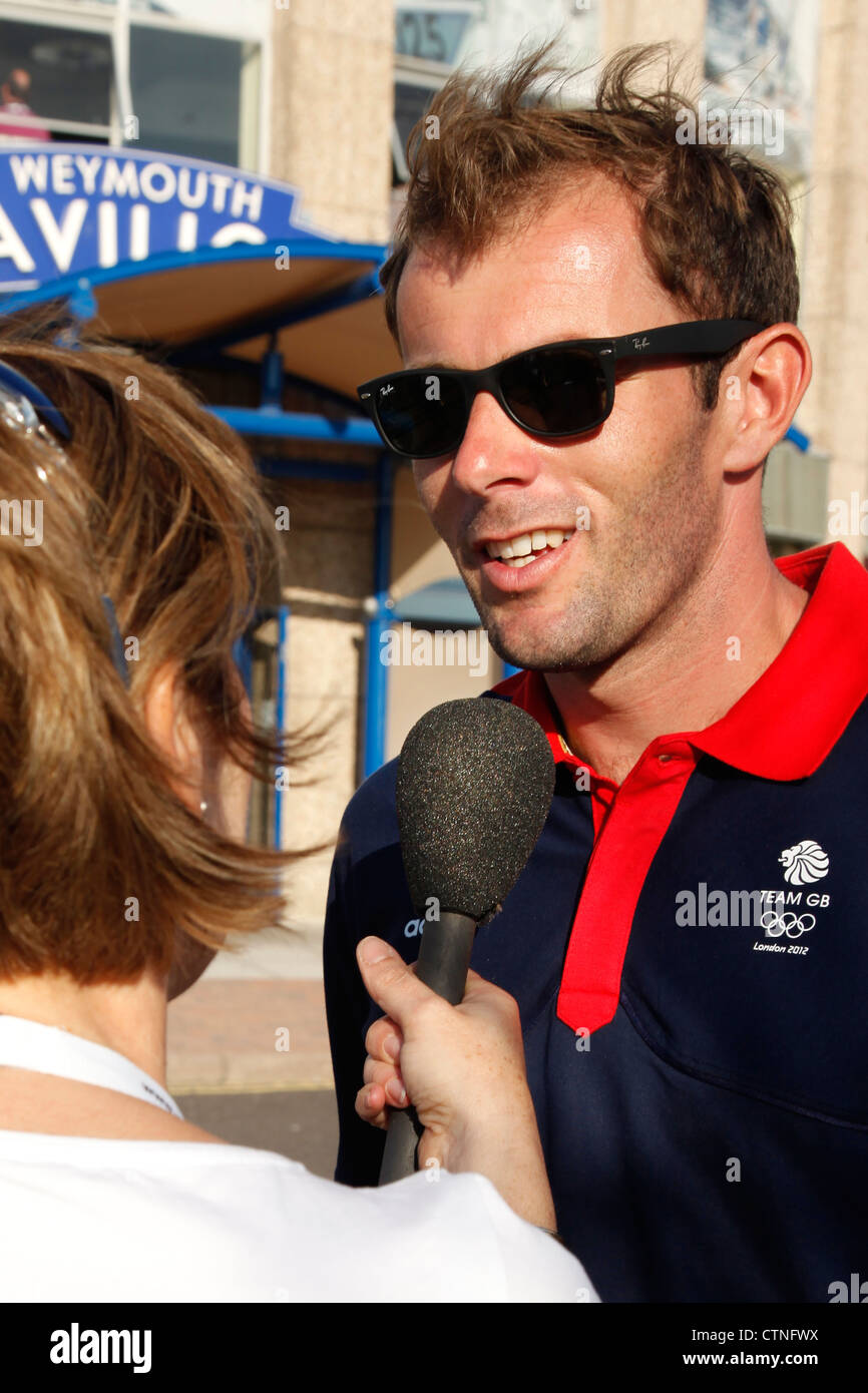 Sailor Paul Goodison is a member of Team Great Britain at London 2012 Olympics, being interviewed at Weymouth Beach, Stock Photo