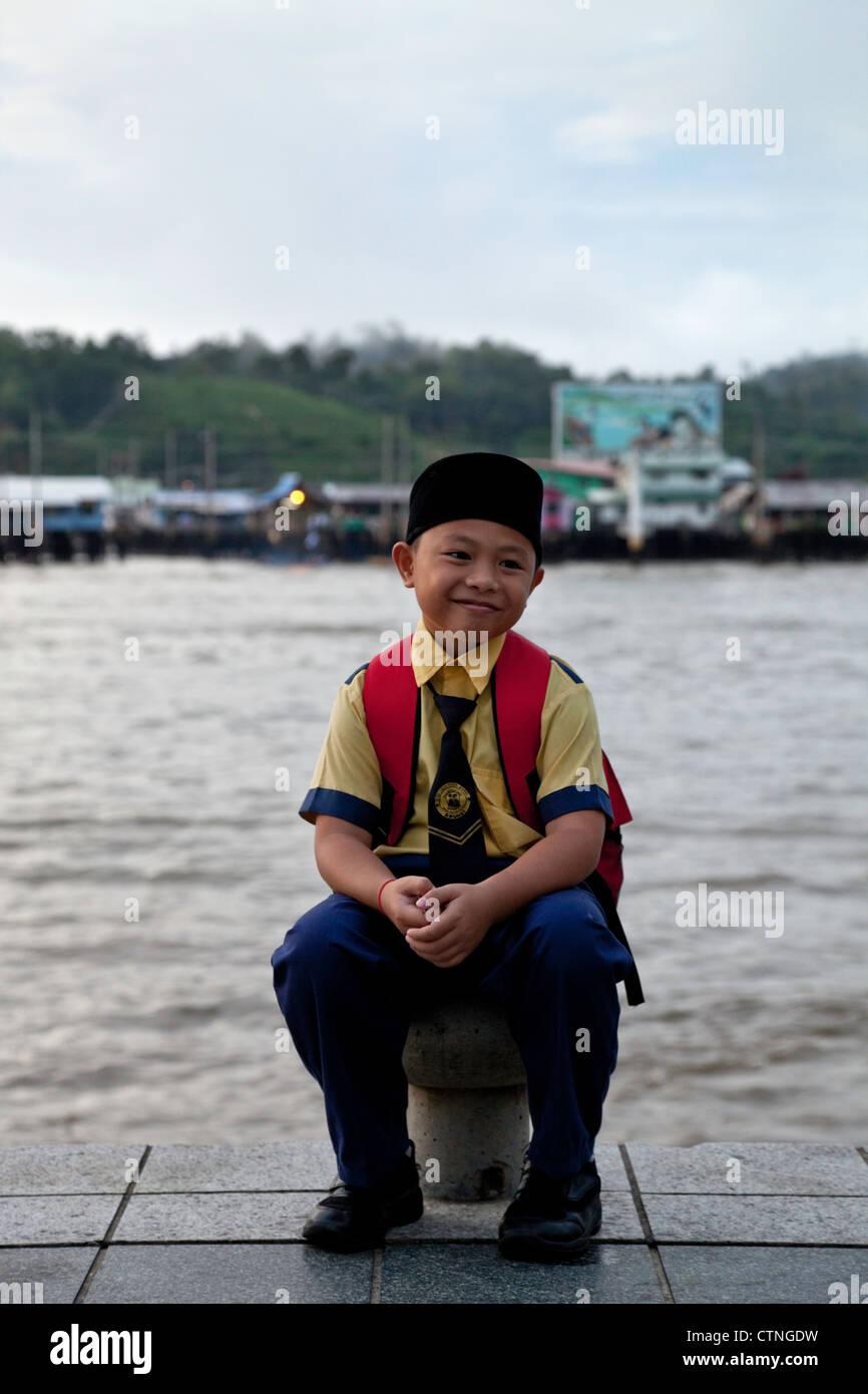 School boy with Kampong Ayer in the background Bandar Seri Begawan Brunei. - Stock Image