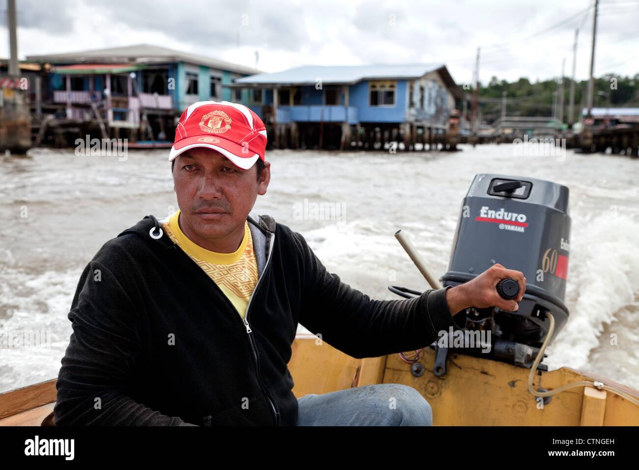 Water taxi driver in Kampong Ayer Bandar Seri Begawan Brunei Borneo Asia. - Stock Image