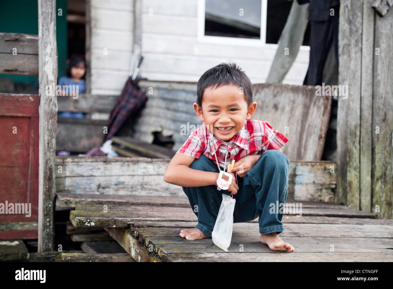 Smiling boy in water village (Kampong Ayer) Bandar Seri Begawan Brunei Borneo Asia. - Stock Image