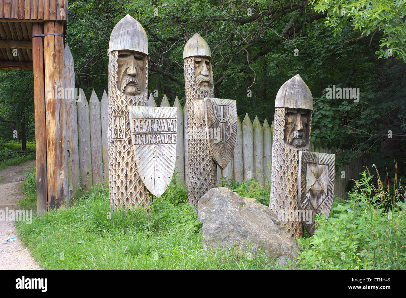 Wooden sculptures Bedkowice ancient Slavic dwelling Lower Silesia Poland - Stock Image