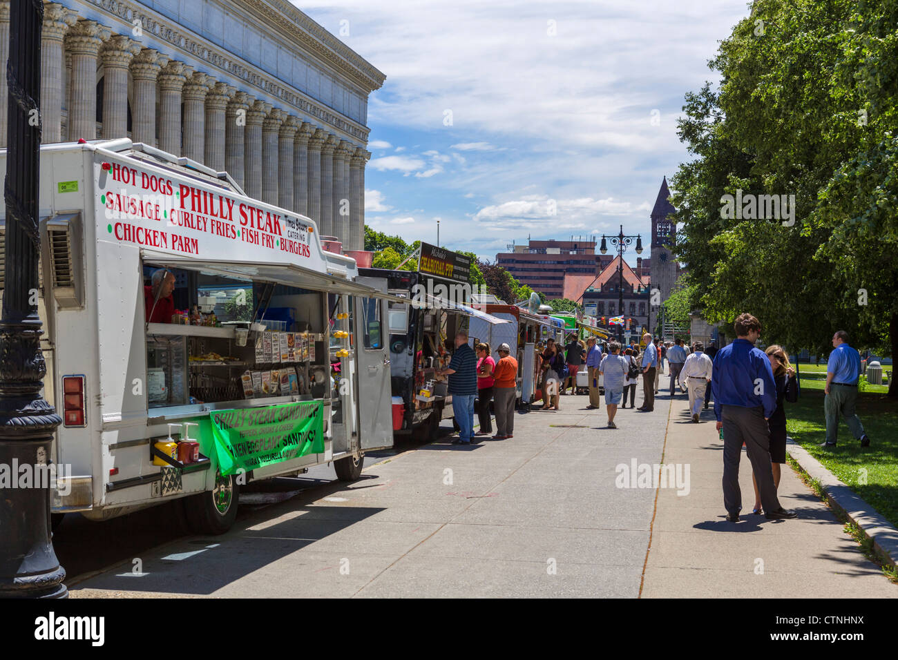 Office workers from state government buildings buying street food from vans on Washington Avenue , Albany, New York - Stock Image