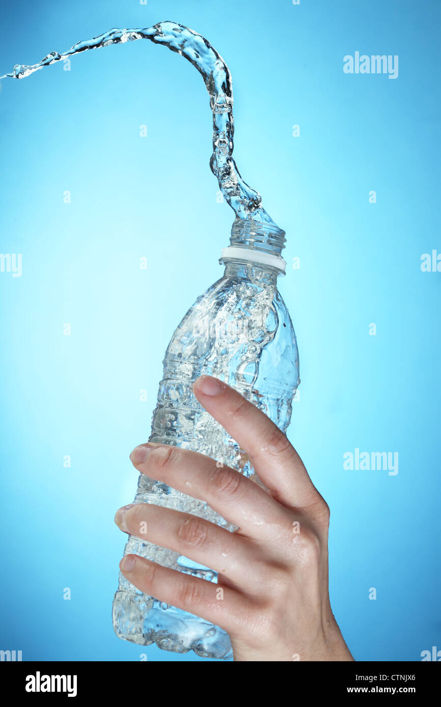 Water splashing out of a water bottle - Stock Image
