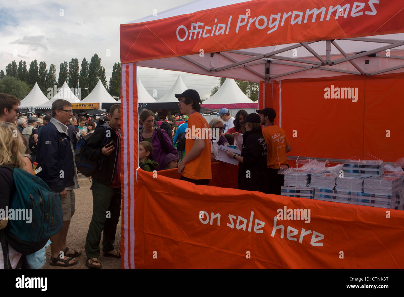Selling official Olympic programmes before the start of the canoe slalom heats at the Lee Valley White Water Centre, - Stock Image
