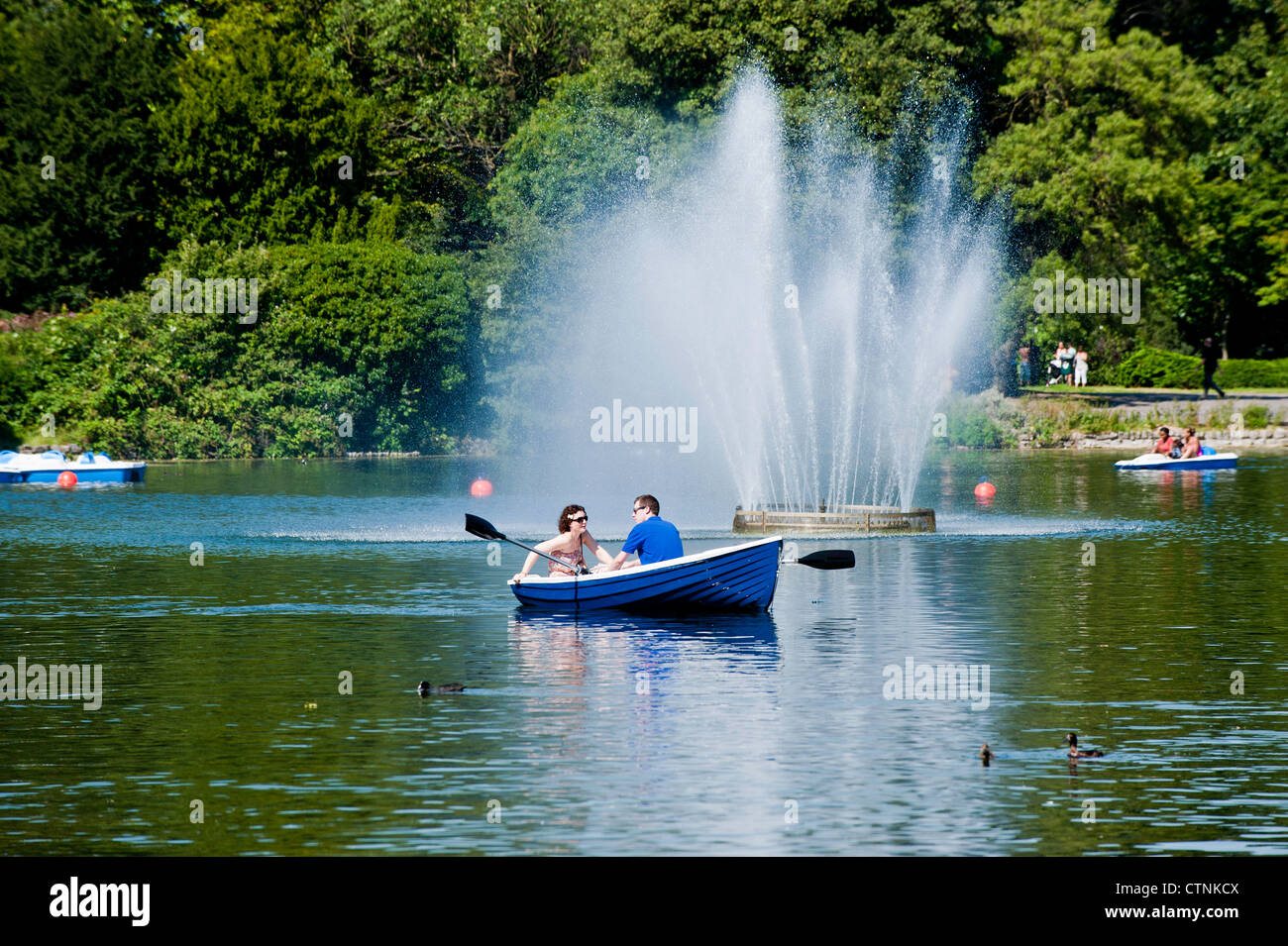 People enjoy boating on hot summer day, Victoria Park, Hackney, London, United Kingdom - Stock Image