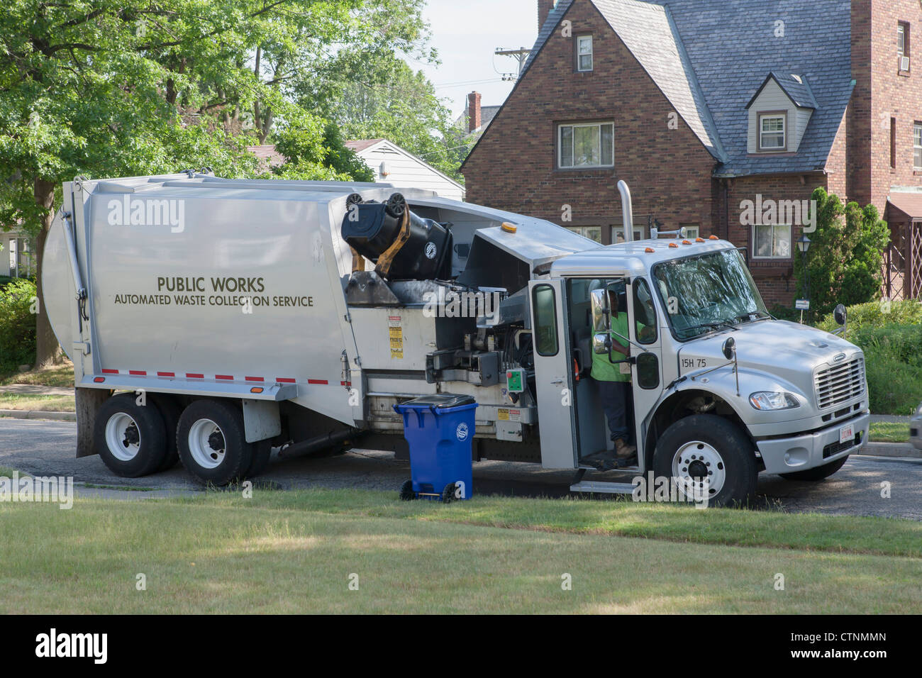 waste collection workers pick up a black waste cart on a suburban stock photo 49649733 alamy. Black Bedroom Furniture Sets. Home Design Ideas
