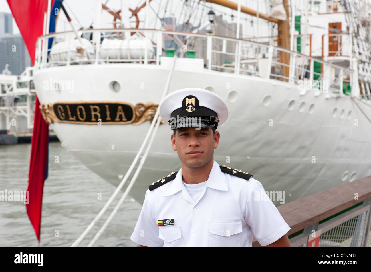 A cadette poses next to the Colombia training ship ARC Gloria during 2012 Fleet Week in New York City - Stock Image