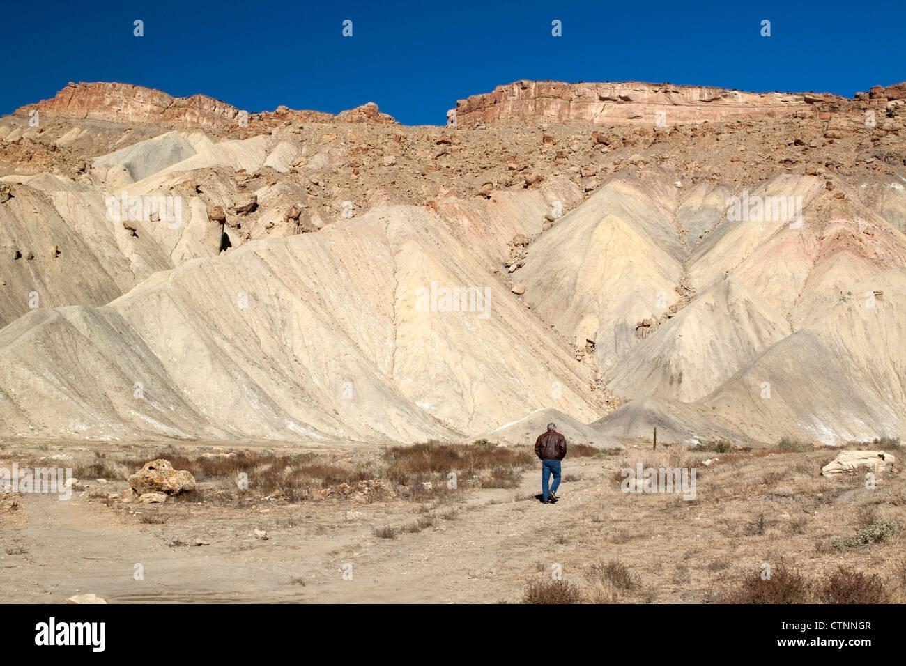 Walker on trail at base of Mt. Garfield, near Palisade, Colorado, USA - Stock Image