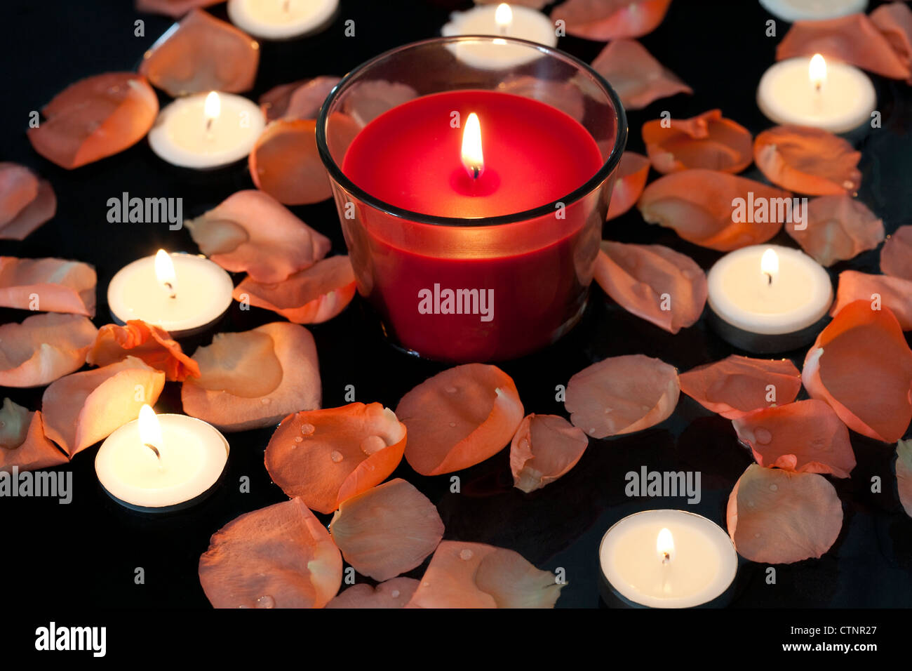 Rose petals and candles Stock Photo