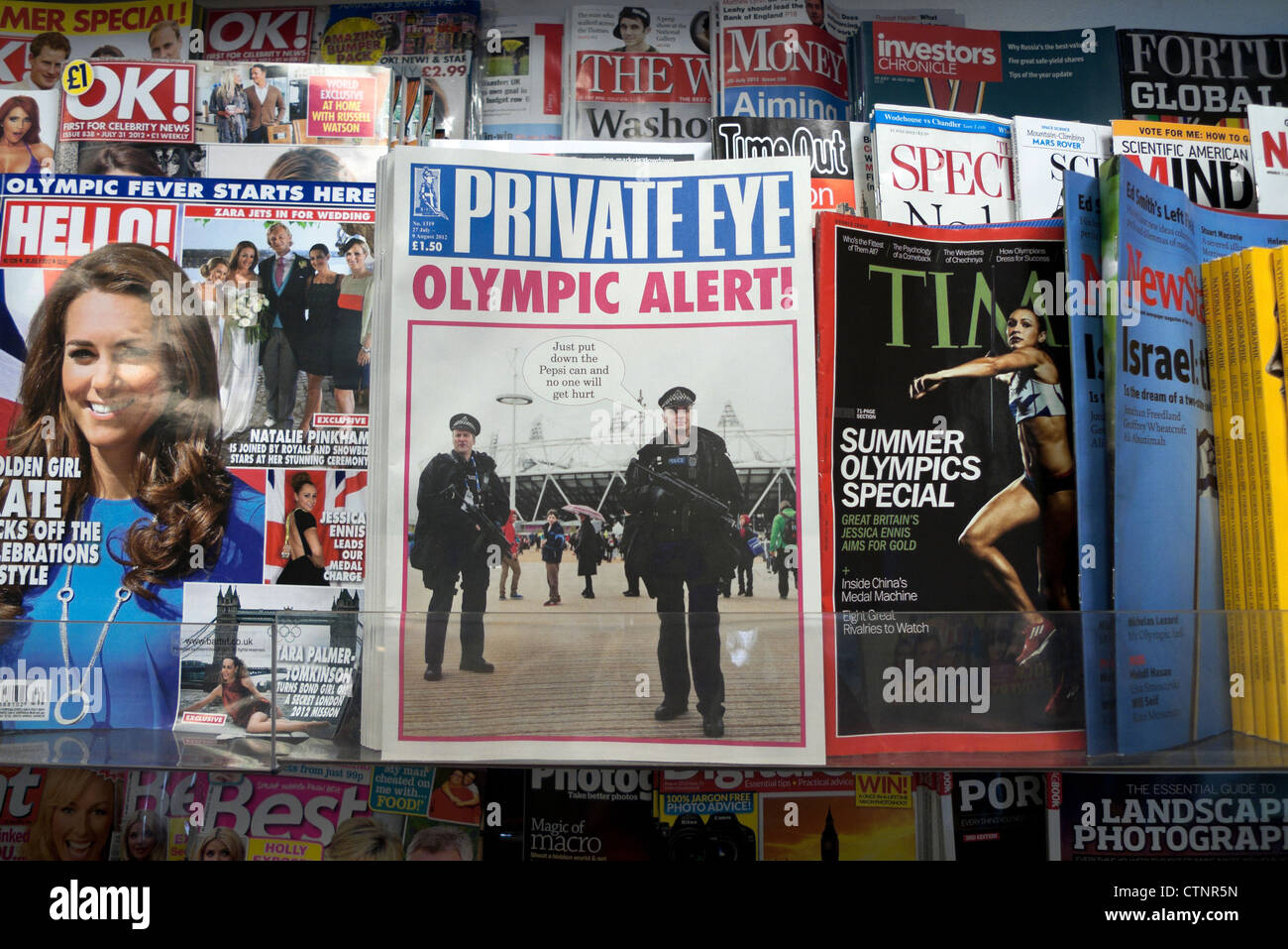 The cover of Private Eye magazine July August issue with  2012 London Olympic Alert headline W H Smith newsagent - Stock Image