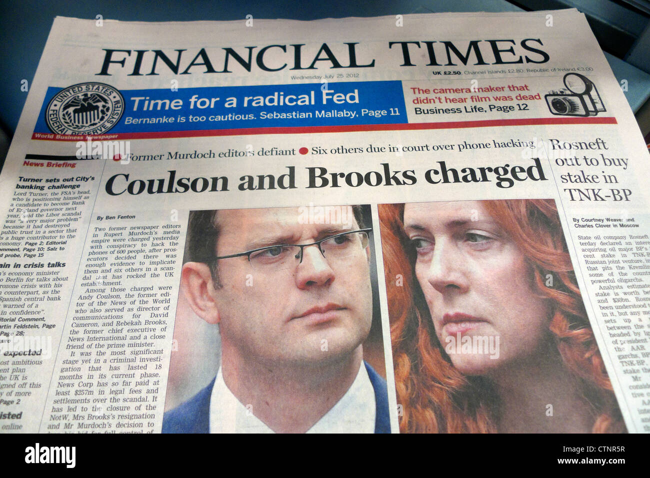Financial Times newspaper headline 'Coulson and Brooks charged' in phone hacking scandal London UK  25 July - Stock Image