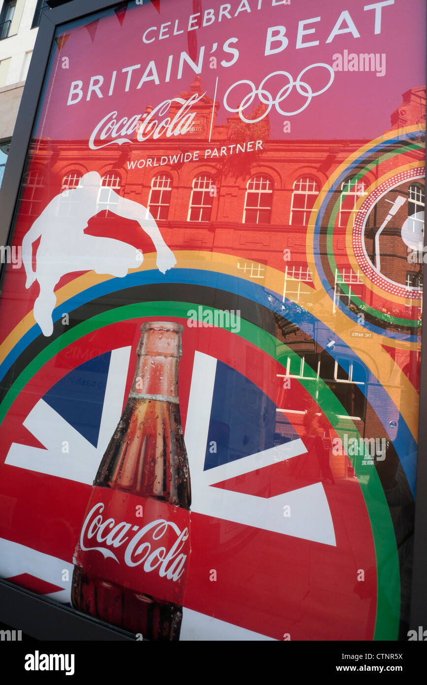 A poster for Coca Cola a corporate sponsor of the 2012 London Olympics in Cardiff City Centre Wales UK KATHY DEWITT - Stock Image