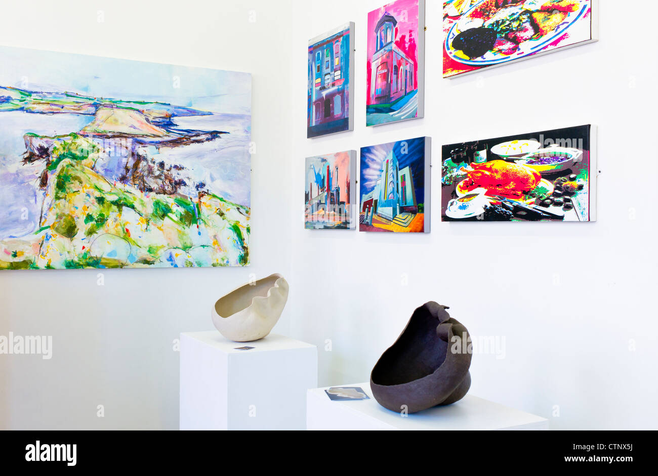 Works of art on display in a gallery - Stock Image