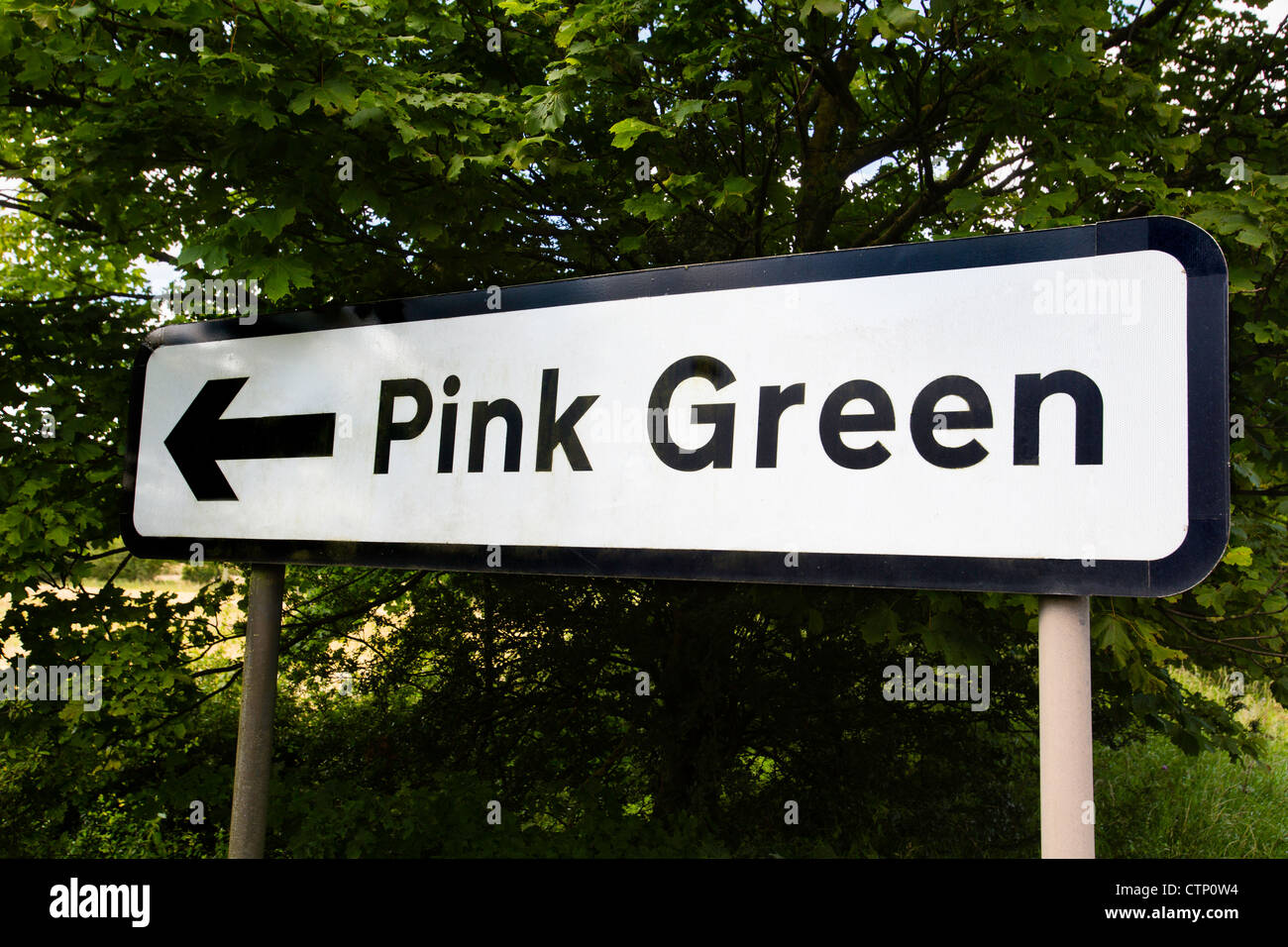 A road sign to the village of Pink Green in Worcestershire, UK - Stock Image