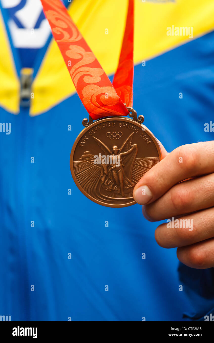 Vyacheslav Glazkov of Ukraine shows his bronze medal from super heavyweight boxing division at the 2008 Summer Olympic - Stock Image