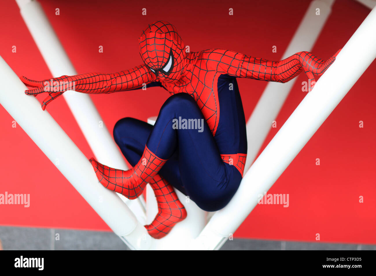 A Cosplay fan in Spiderman outfit - Stock Image