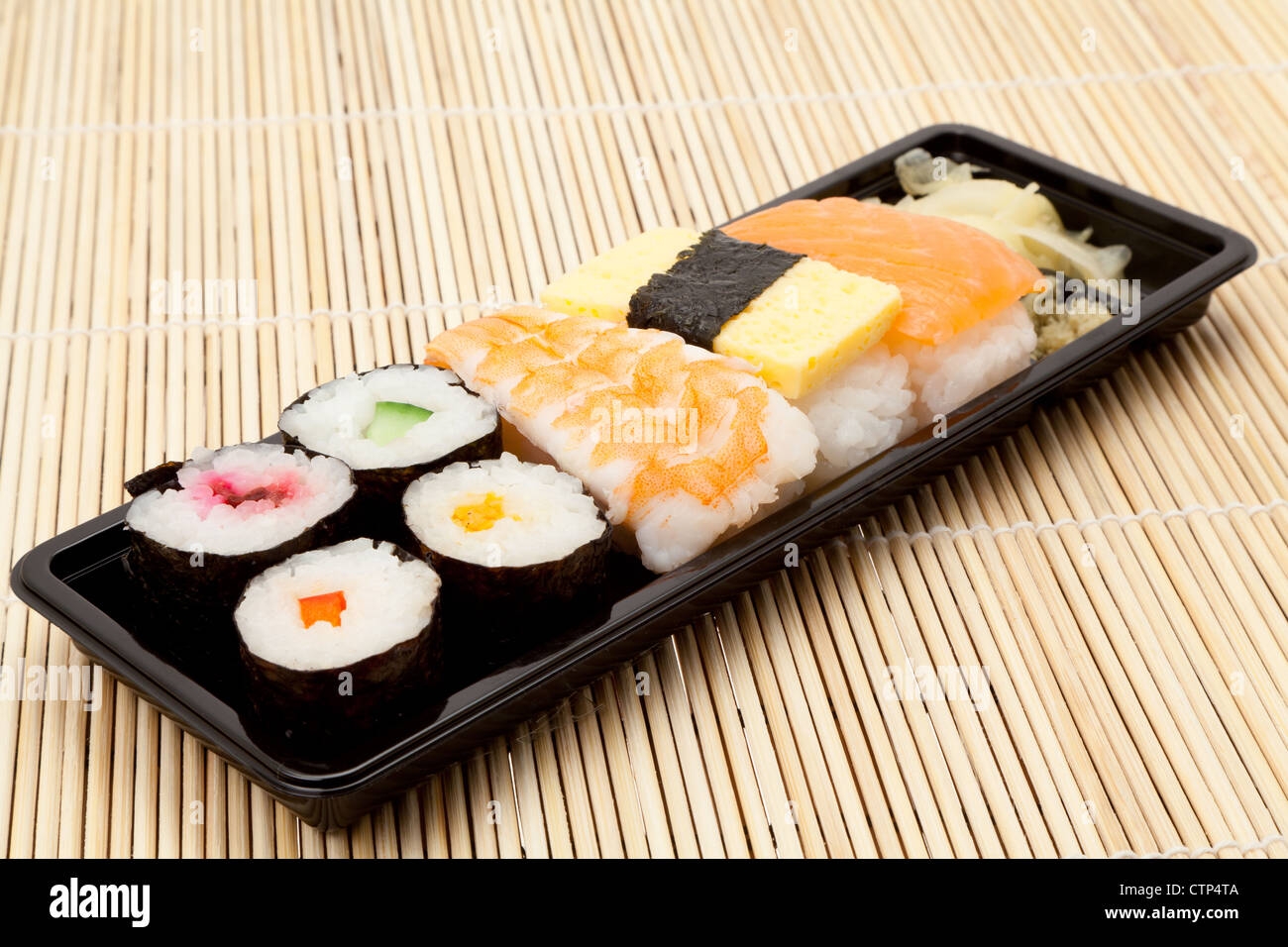 Tray of various Sushi items on a place mat - studio shot - Stock Image