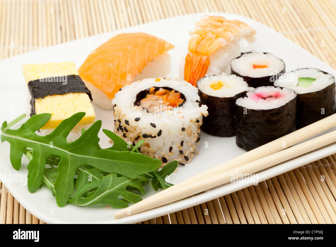Plate of Sushi mix with chop sticks - studio shot - Stock Image