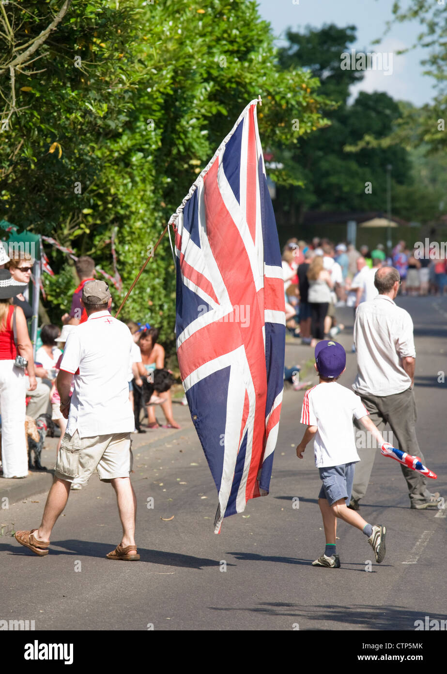 London 2012 Olympic Games. Gathering for men's cycle road race at Ripley, Surrey. - Stock Image