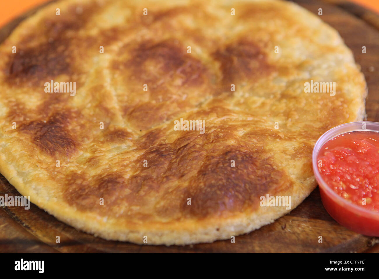 Malawach or malawah is a fried bread originally of Yemen. Malawach resembles a thick pancake - Stock Image
