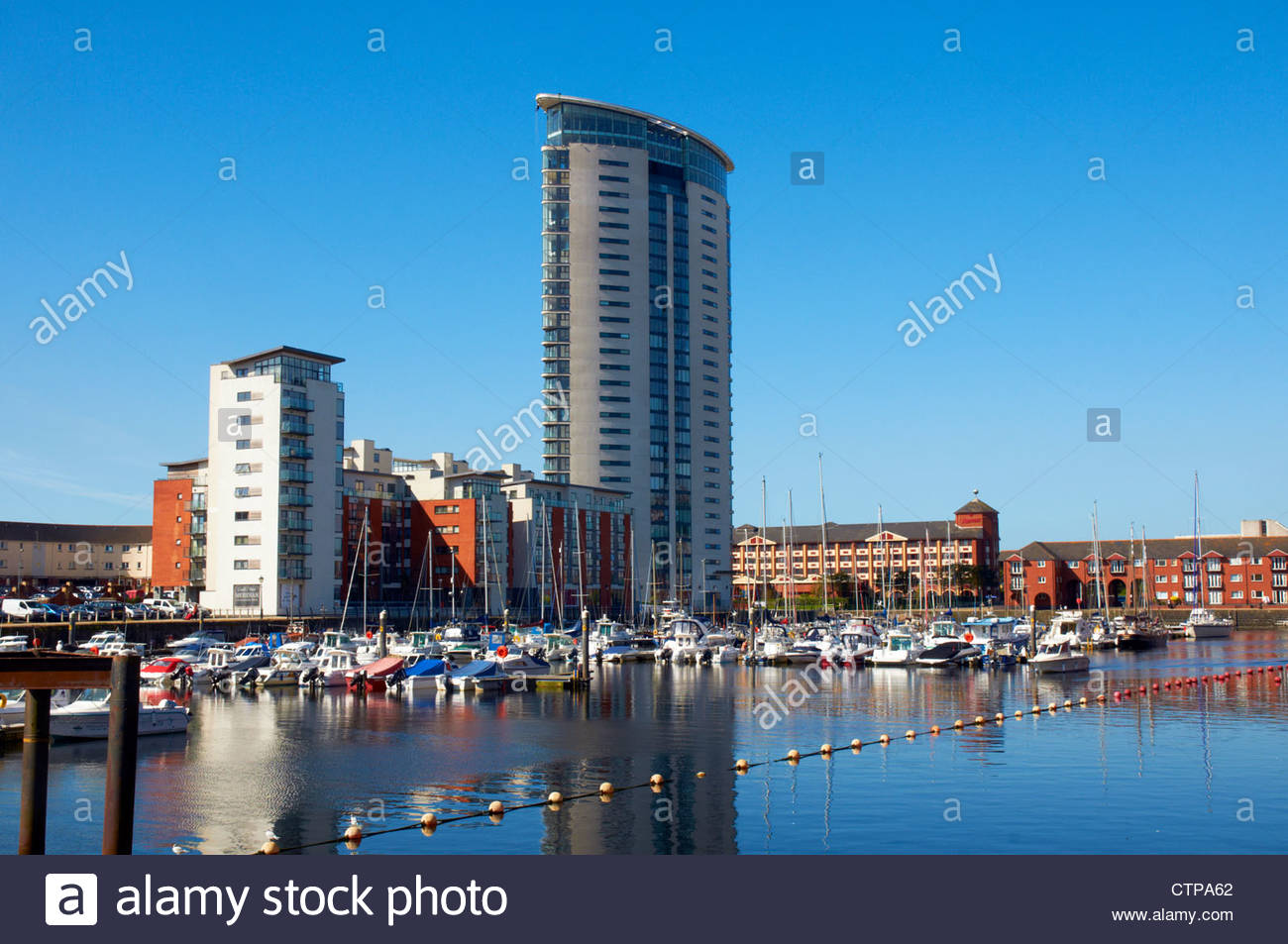 meridian tower block apartments and flats overlooking pleasure boats moored in swansea waterfront marina SA1 - Stock Image