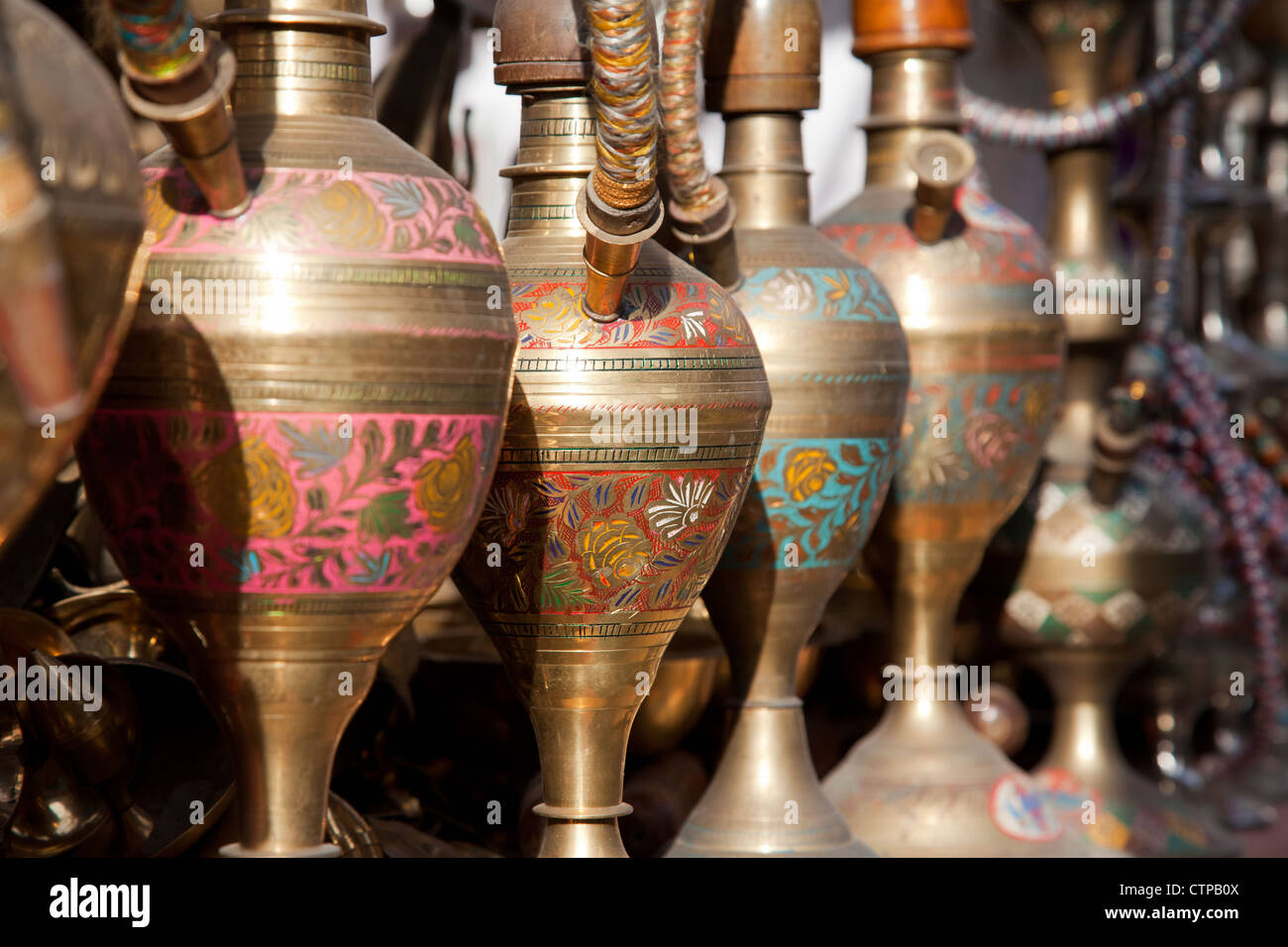 Close-up of Indian water pipes / hookah at market stall in Jodhpur, Rajasthan, India - Stock Image