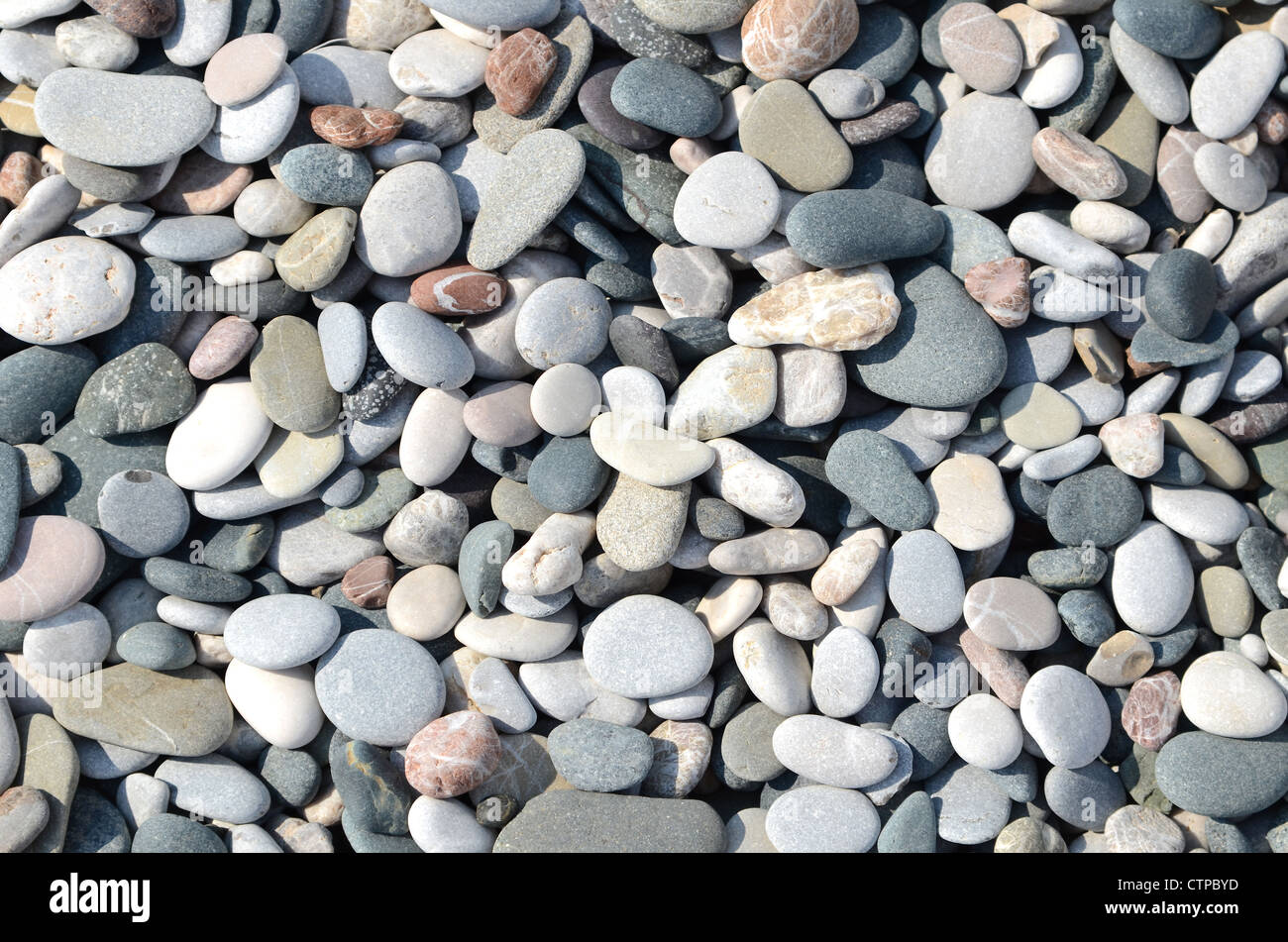 A stone background from a dry river bed Stock Photo