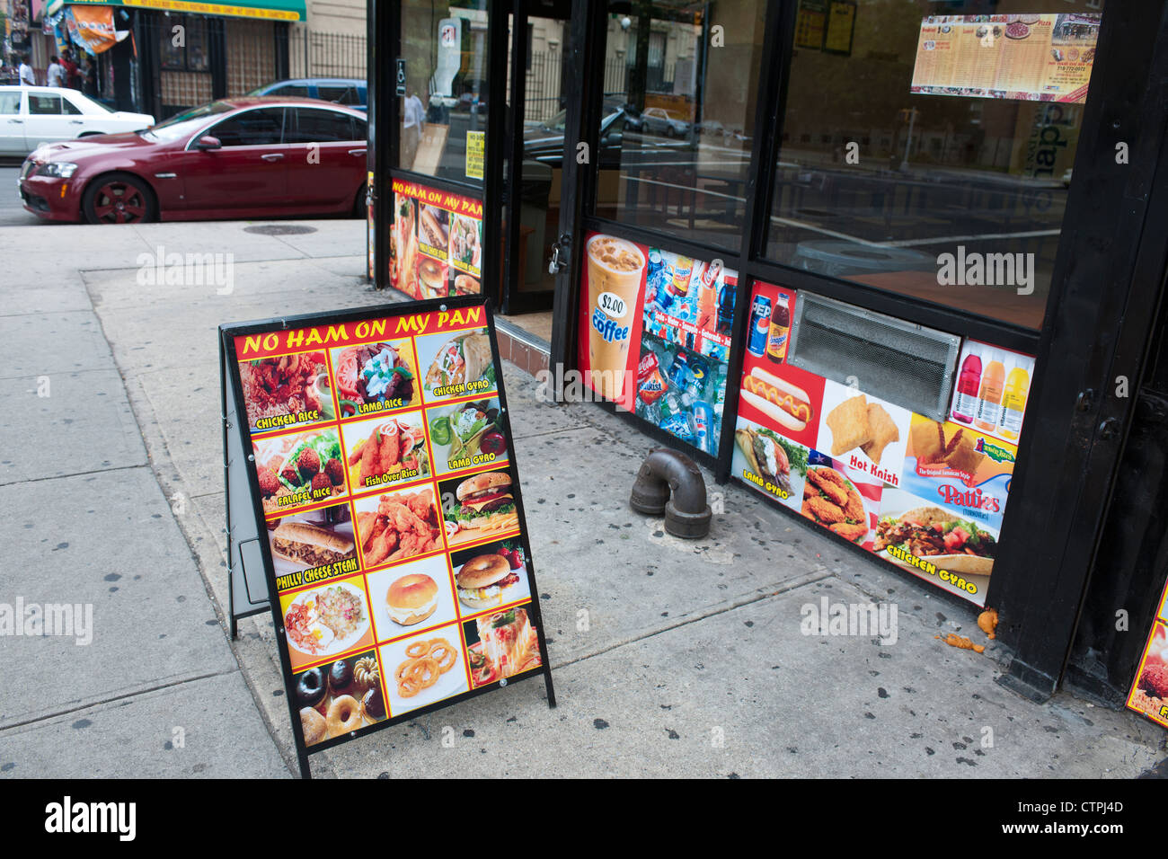 Makkah Pizza in Harlem in New York proudly proclaims 'No Ham On My Pan' on its advertising - Stock Image