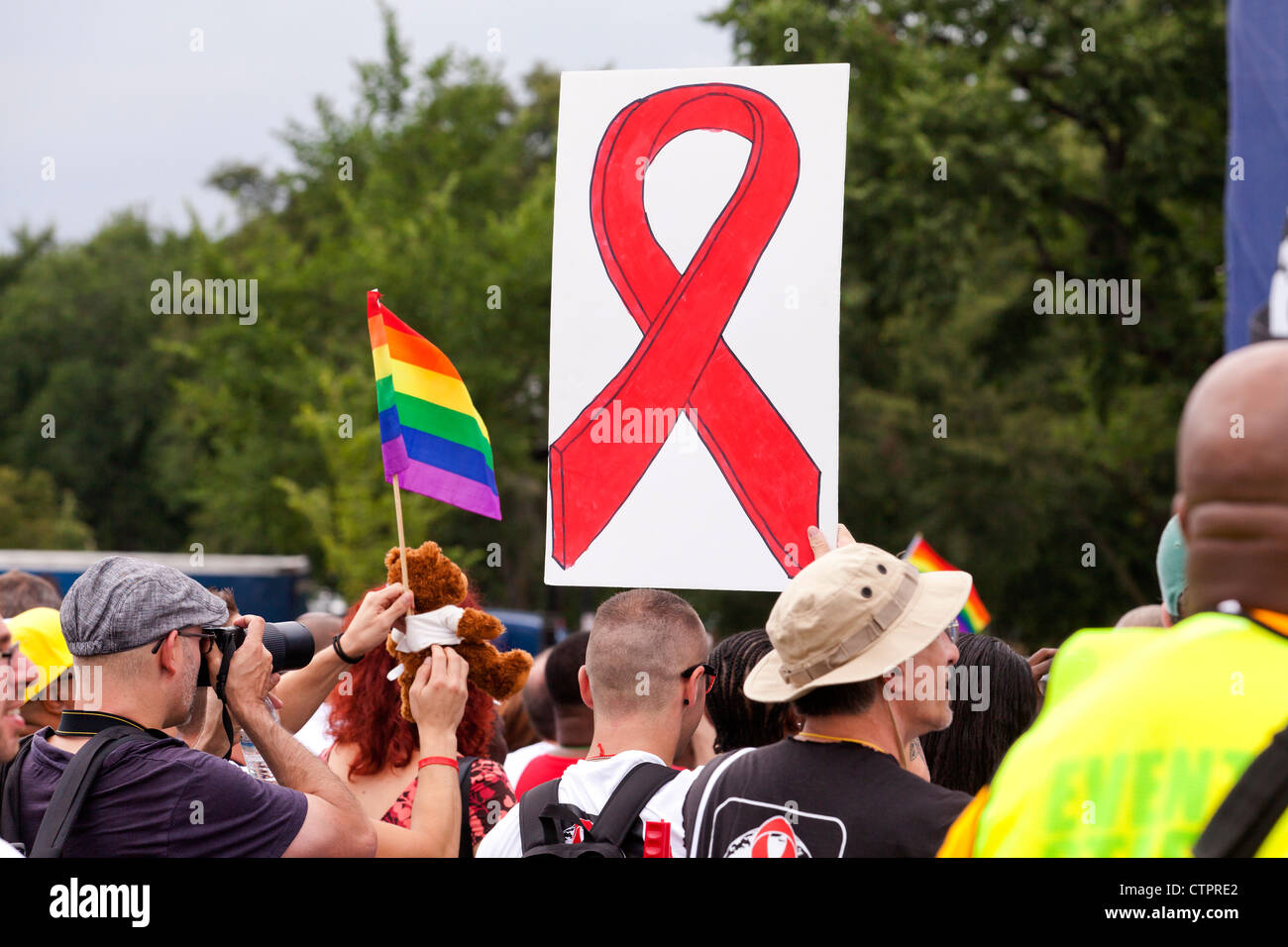 A man holding up an HIV AIDS awareness ribbon sign - July 22, 2012, Washington, DC USA - Stock Image