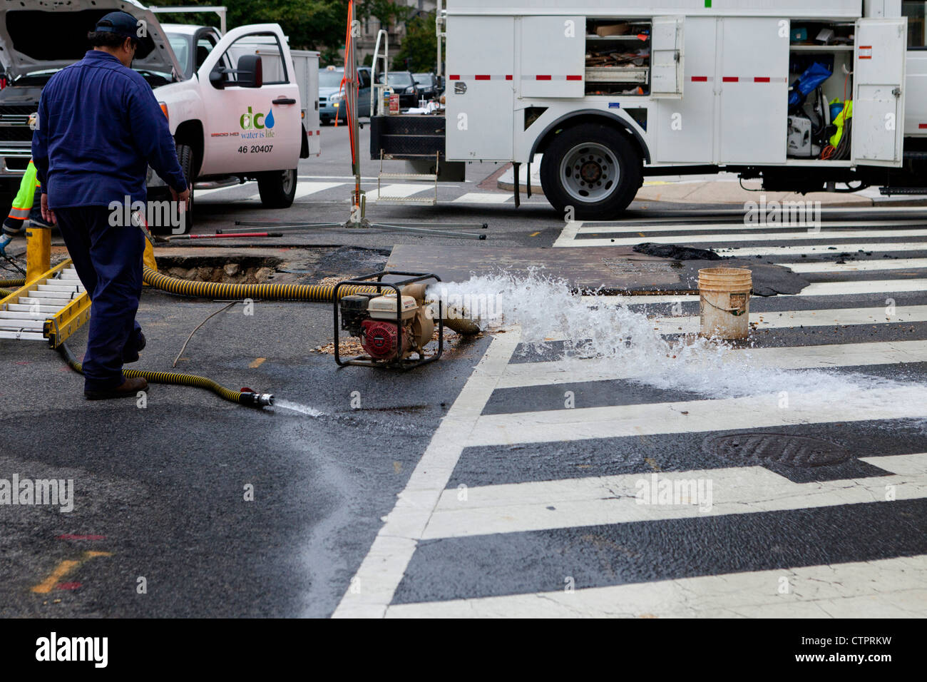 A motorized water pump used in the sewer system - Stock Image