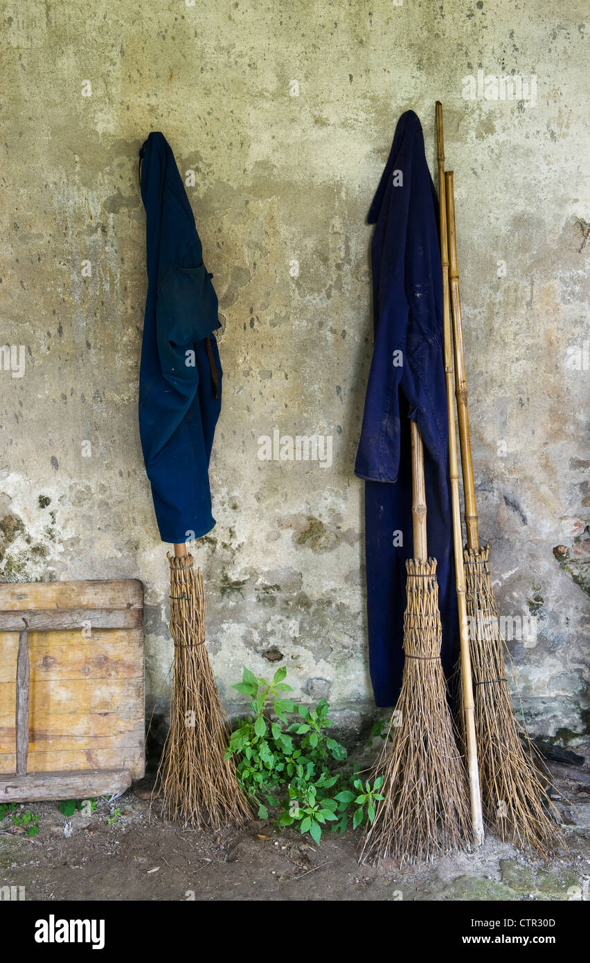 Gardeners' twig brooms stand ready for use in an Italian garden Stock Photo