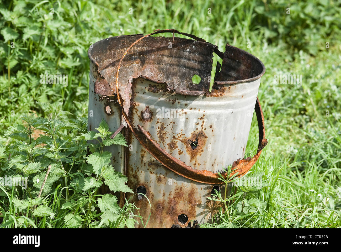 Old rusting incinerator on waste land in a garden Stock Photo