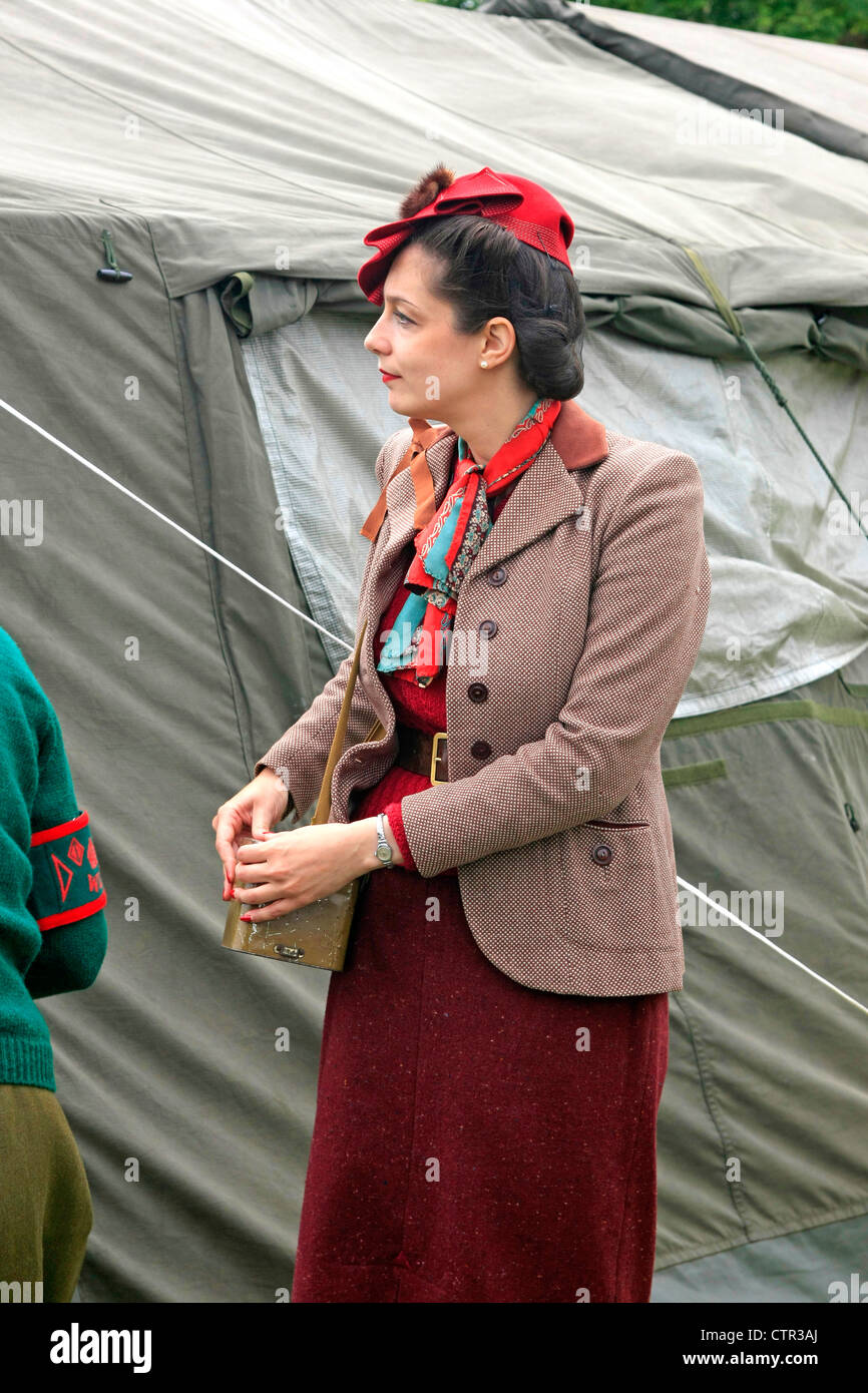 Adult woman dressed in WW2 clothing at a re-enactors show