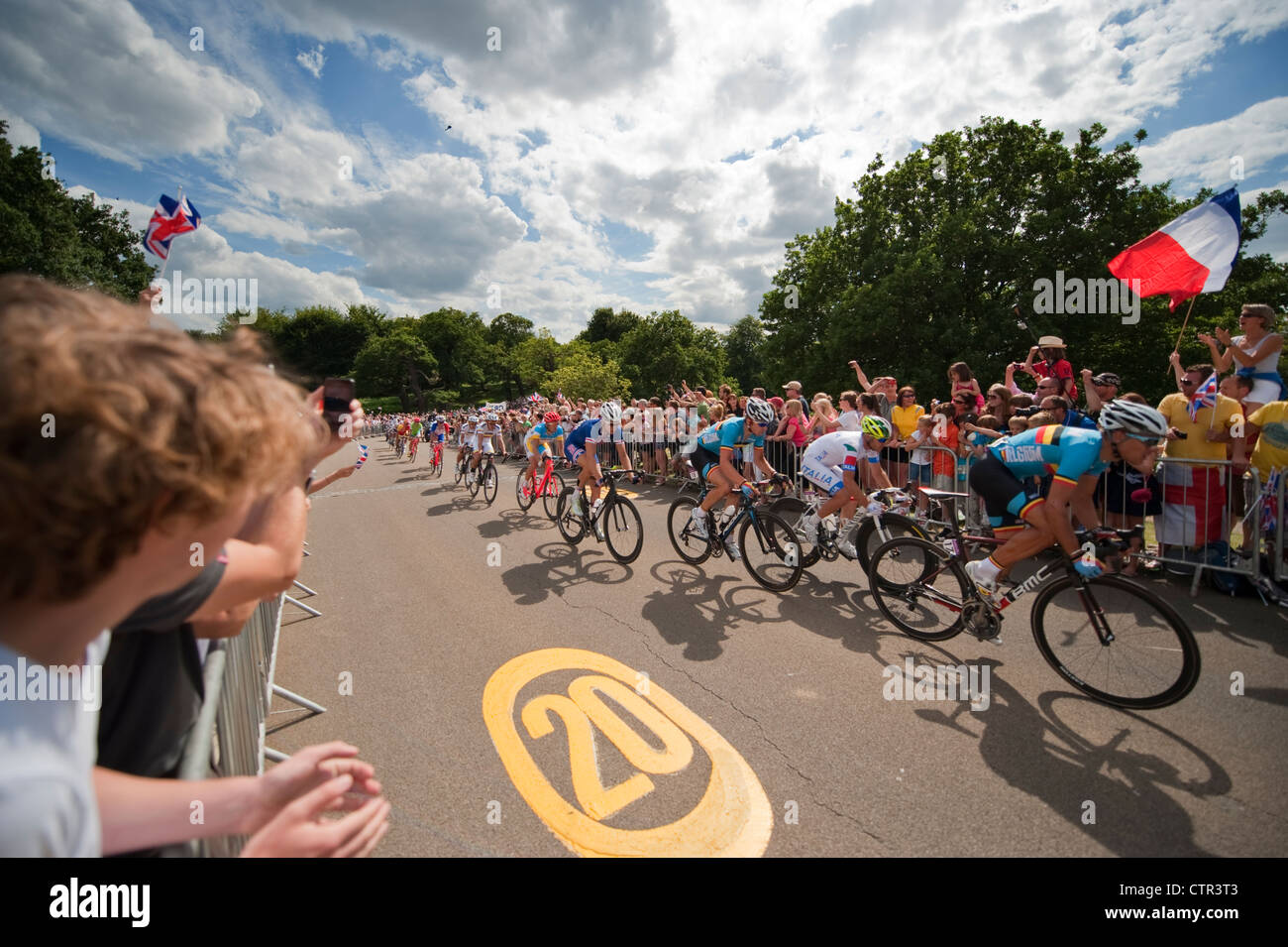 London Olympic Games 2012, Cycling; Mens Road Race inbound in Richmond Park 28.7.12 with cheering spectators - Stock Image