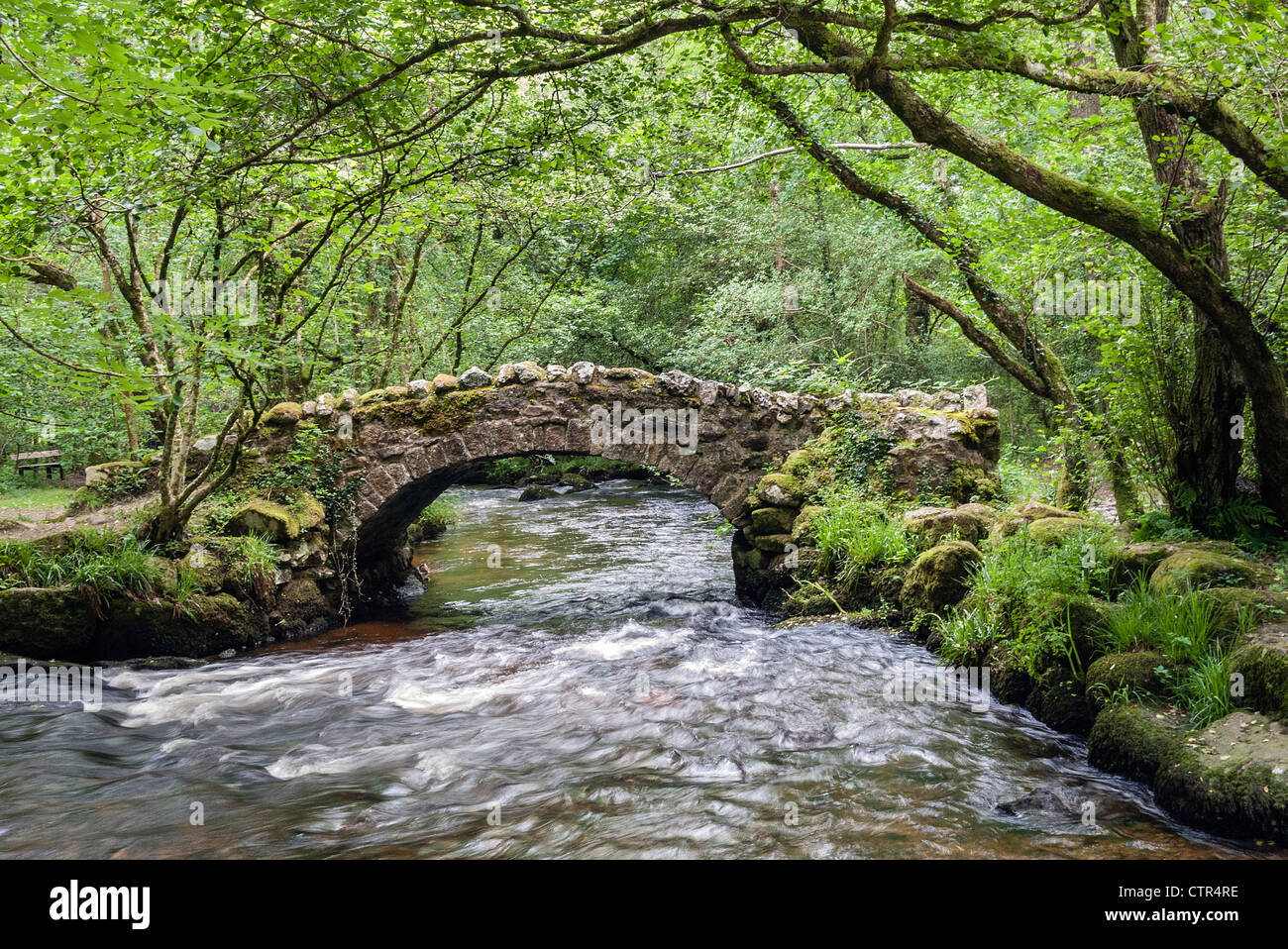 Packsaddle Bridge over the river Bovey, near Bovey Tracey, Dartmoor, Devon, England, UK. - Stock Image