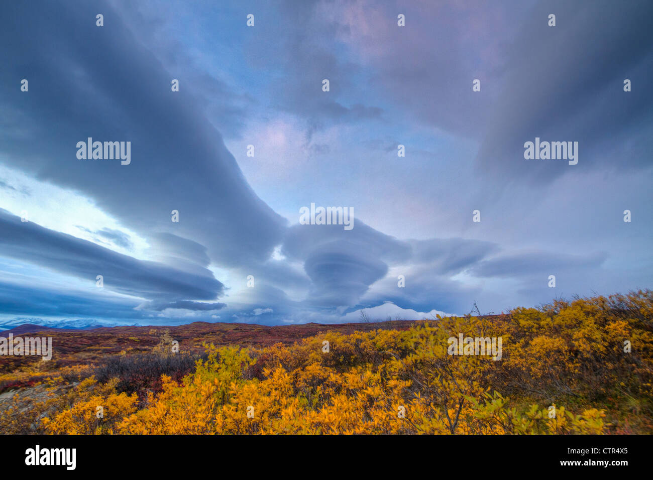 Dramatic lenticular cloud formation over the Maclaren River Valley, Southcentral Alaska, Autumn - Stock Image