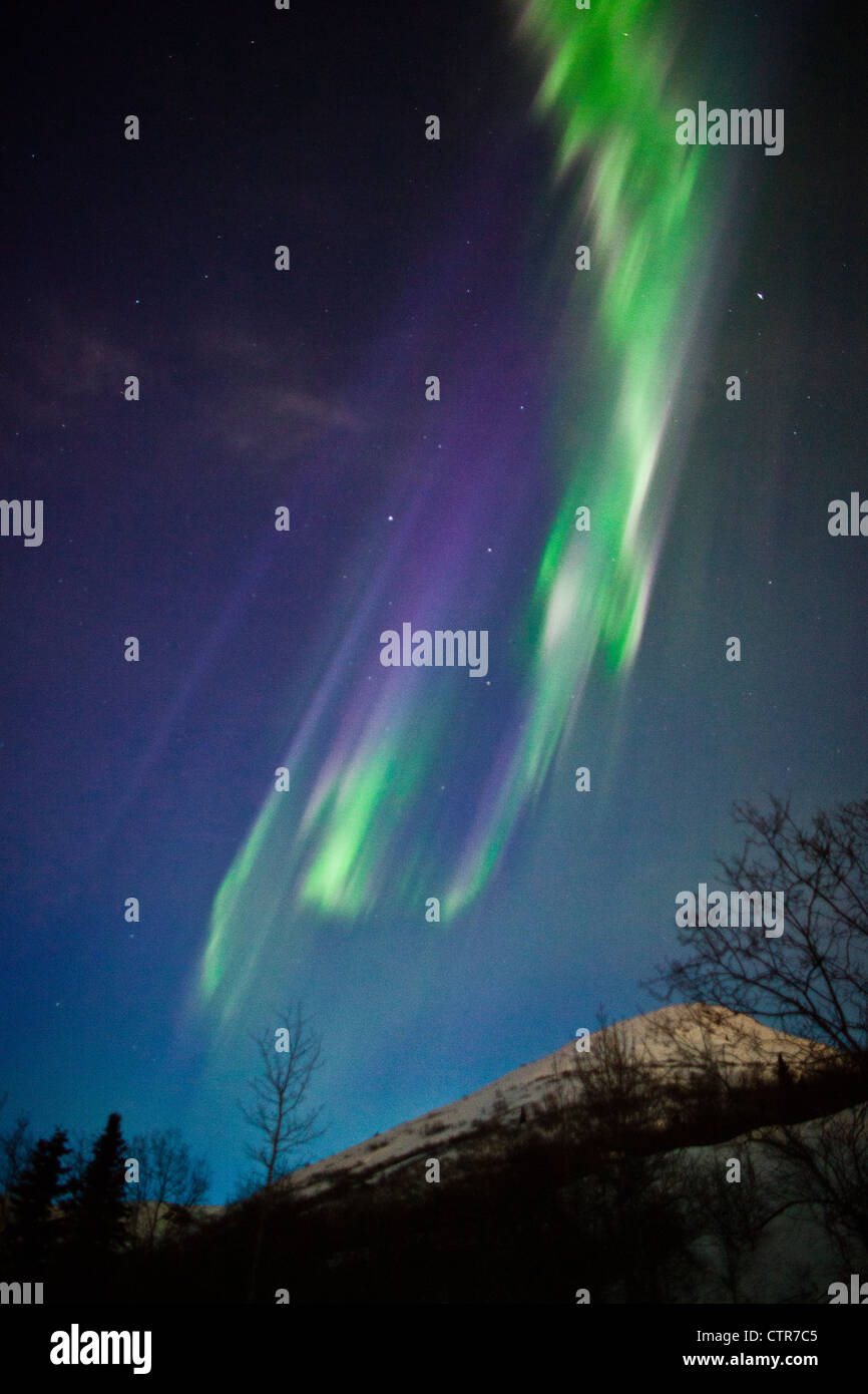 View of the Aurora Borealis over the Chugach Mountains, Southcentral Alaska, Winter - Stock Image