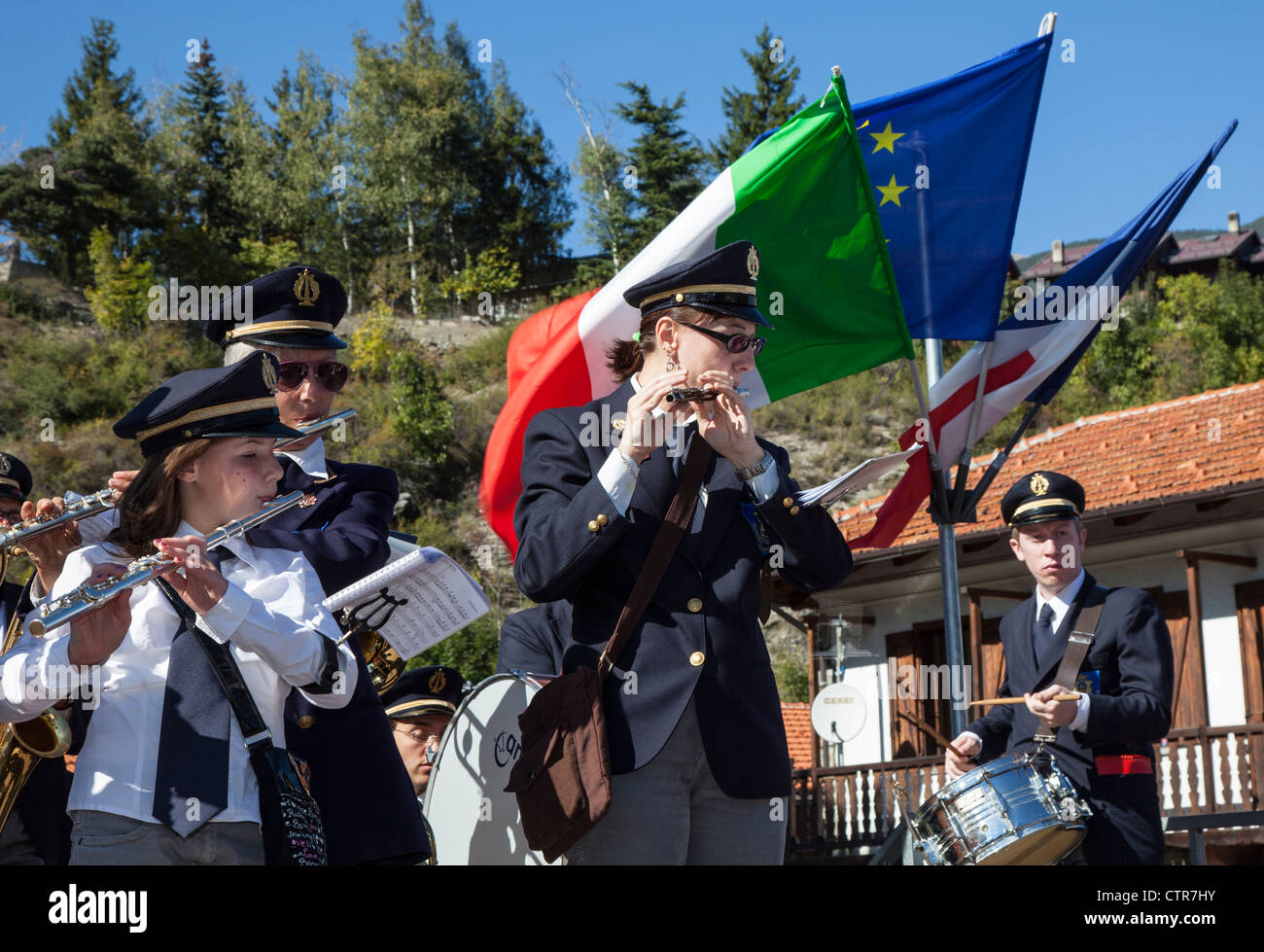 Italian town band playing music instruments at a festival in Oulx, Piemonte, Italy - Stock Image