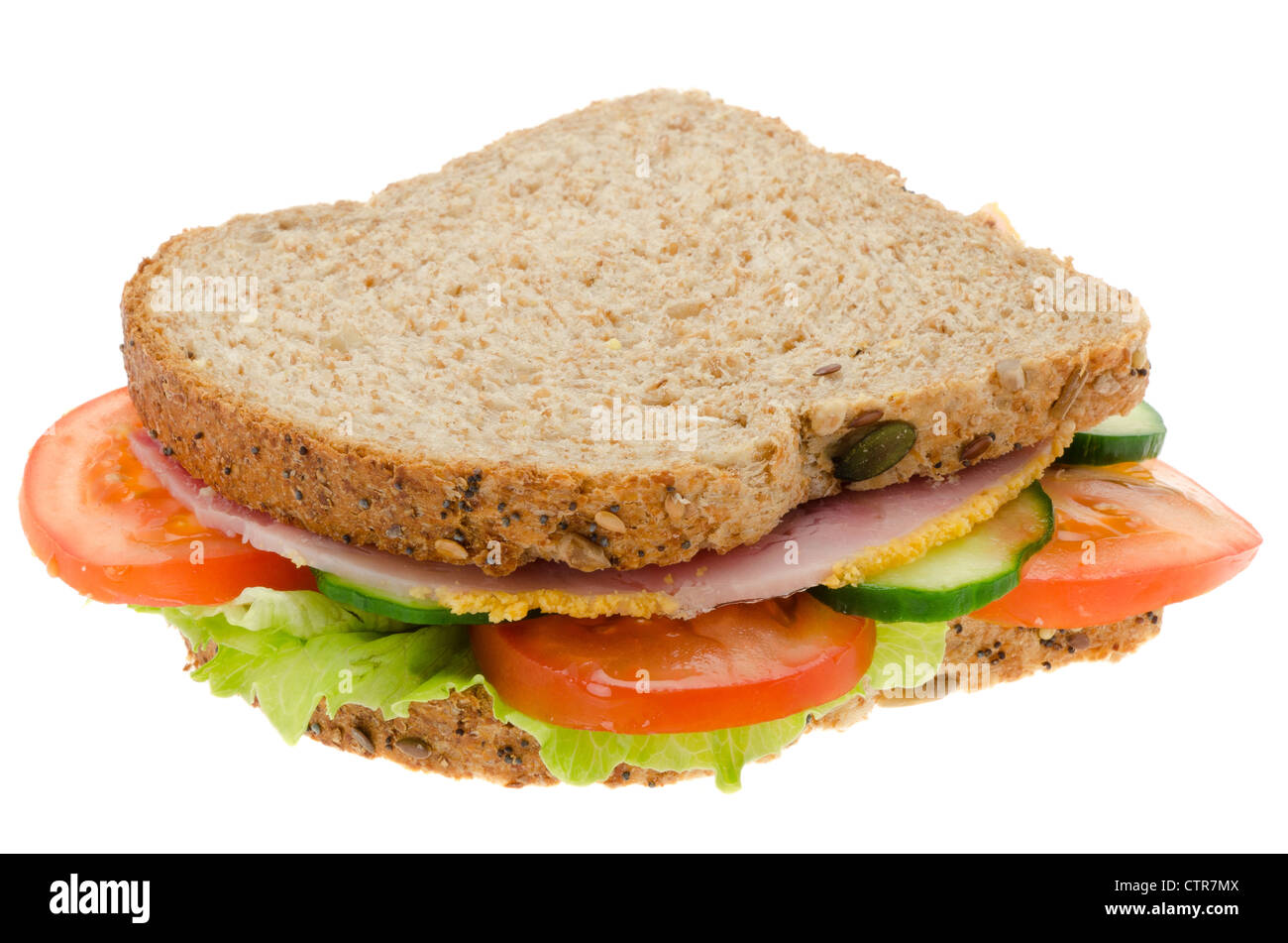 Fresh ham and salad sandwich with granary bread - studio shot with a white background - Stock Image