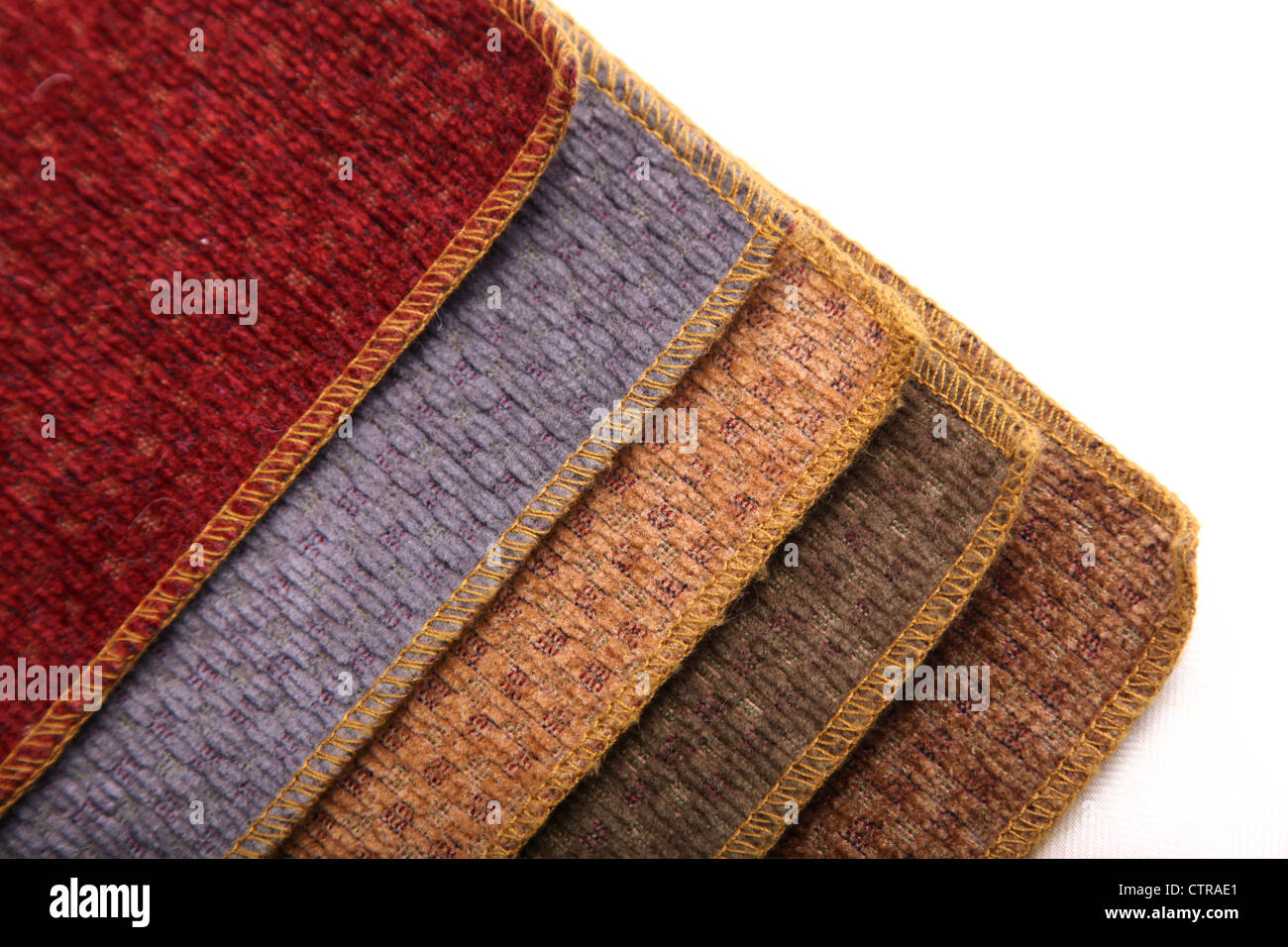 A book of upholstery carpet samples. - Stock Image