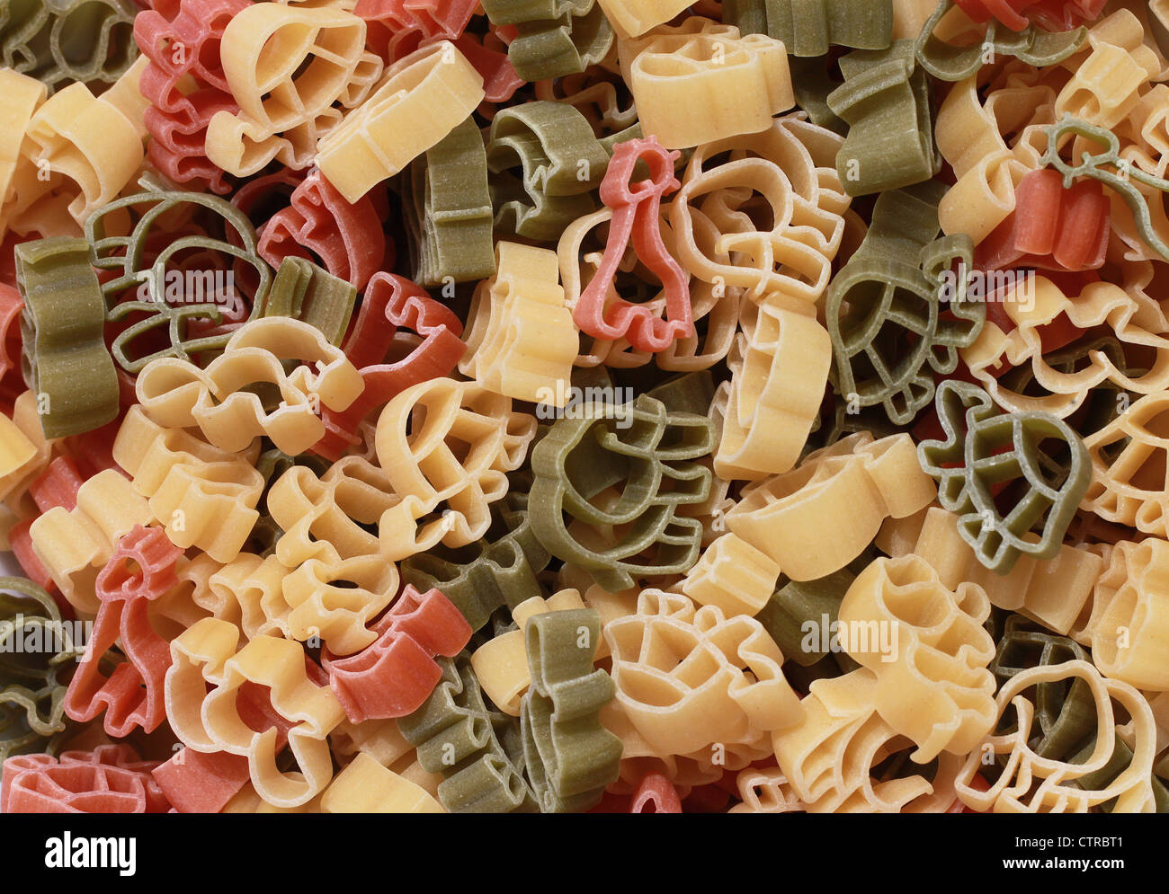 Italian pasta of durum wheat semolina with tomato and spinach in form of various zoo animals. Funny for children. - Stock Image