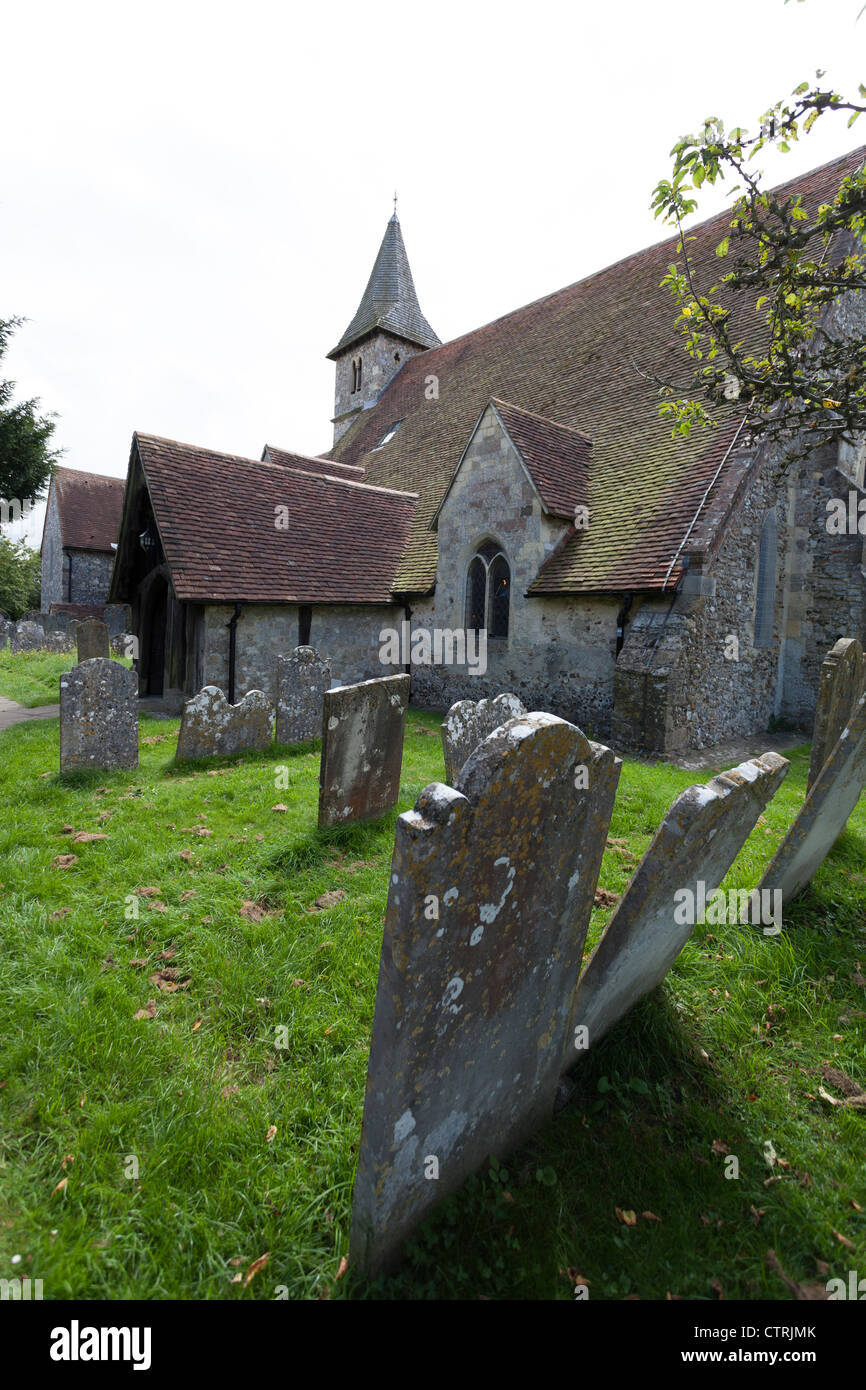 The 12C Church St Thomas à Becket, Warblington and gravestones in the churchyard - Stock Image