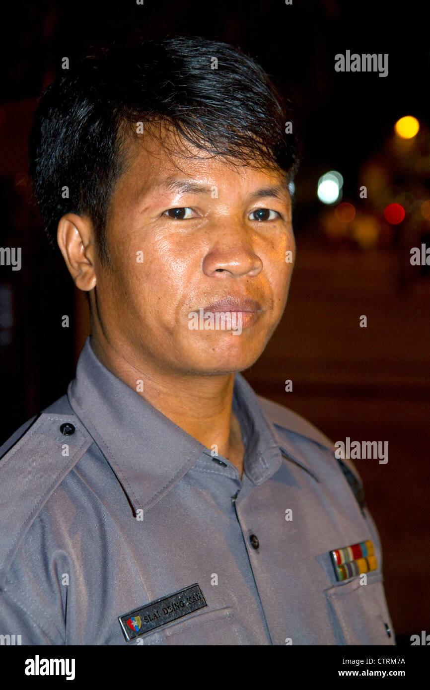 Burmese police officer in (Rangoon) Yangon, (Burma) Myanmar. - Stock Image