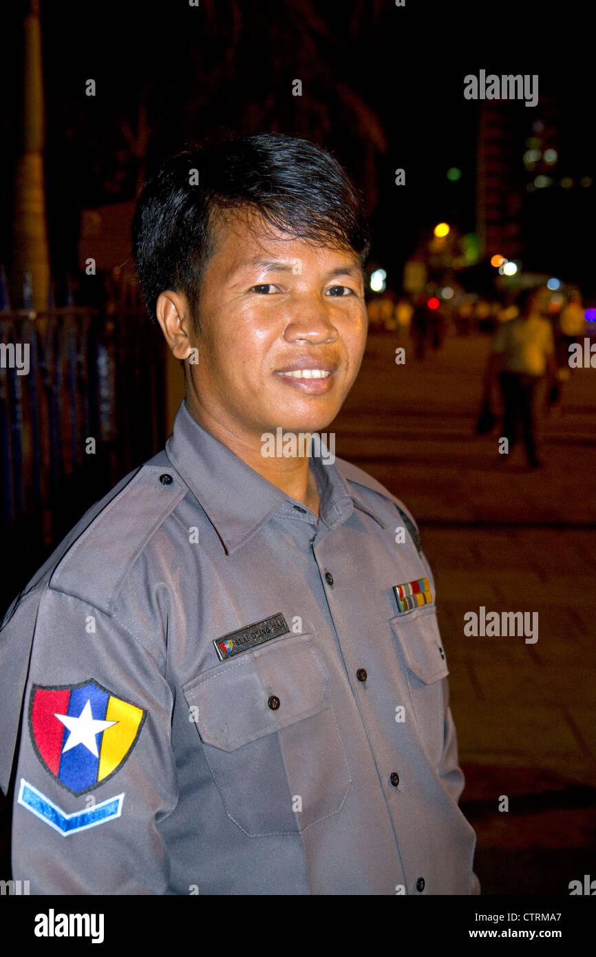 Burmese police officer in (Rangoon) Yangon, (Burma) Myanmar. Stock Photo