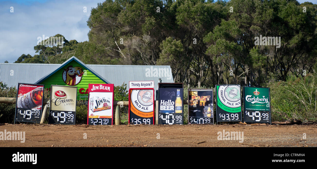 Signs advertising beer for sale on a roadside in Western Australia - Stock Image