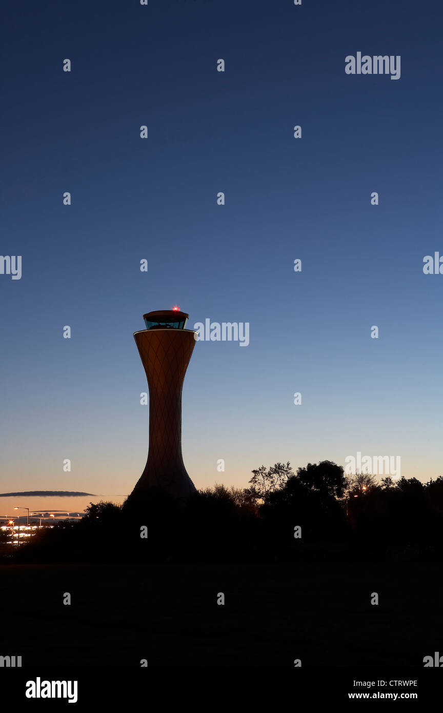 air traffic control tower sillouette view at dawn - Stock Image