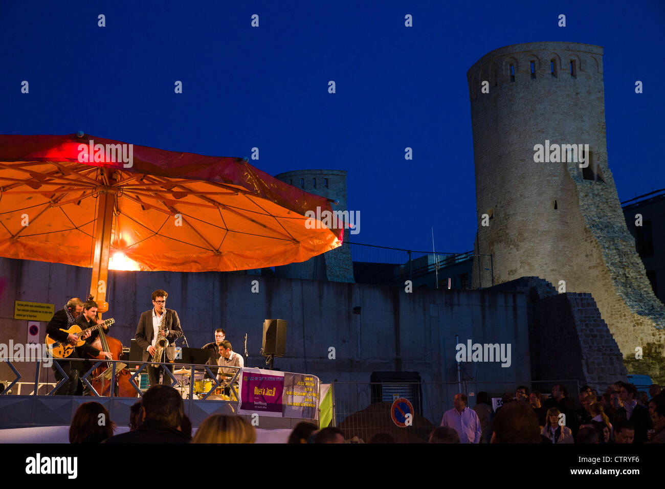 Greg Lamy 4tet and guests playing at the Rham Plateau at the Blues and Jazz Rallye.In the background a tower of - Stock Image