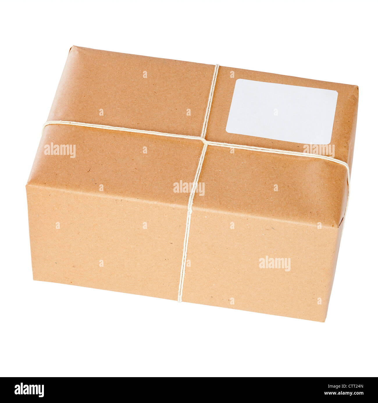 Brown Paper Parcel, tied with string, isolated on white. Fully in focus, front and back. - Stock Image