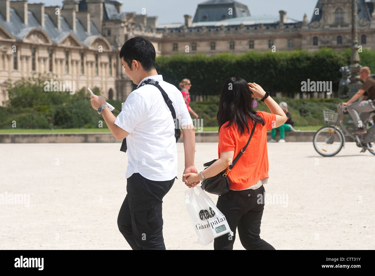 Paris, France - Asian couple hand on hand visiting the city. Stock Photo