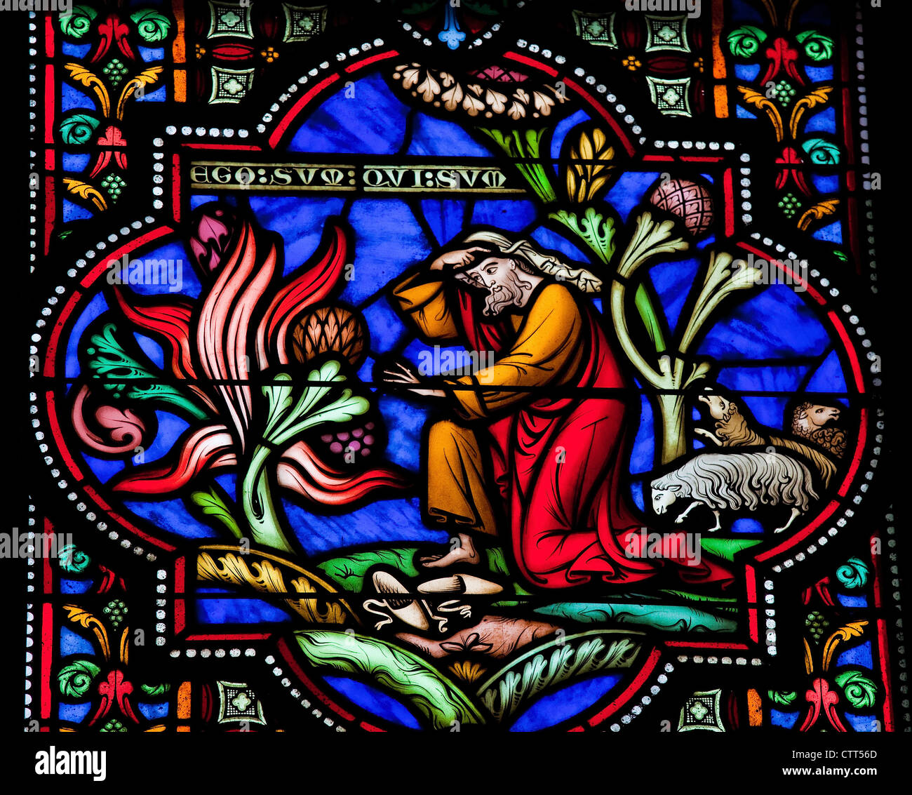 Moses and the burning bush on Mount Horeb. This window was created more than 150 years ago, no property release - Stock Image